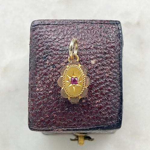 Antique 9ct gold and ruby flower charm