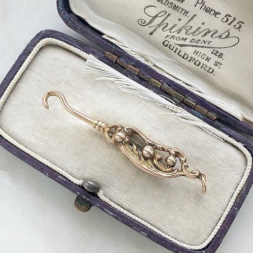 Antique Victorian 9ct gold button hook charm