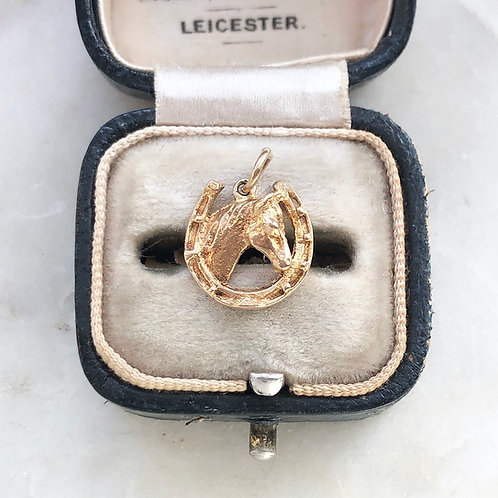 Vintage 1973 9ct gold horse in a horseshoe charm