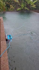 Robot Pool vacum cleaner working in the rain