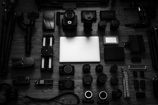 Video and camera equipment laid out on table