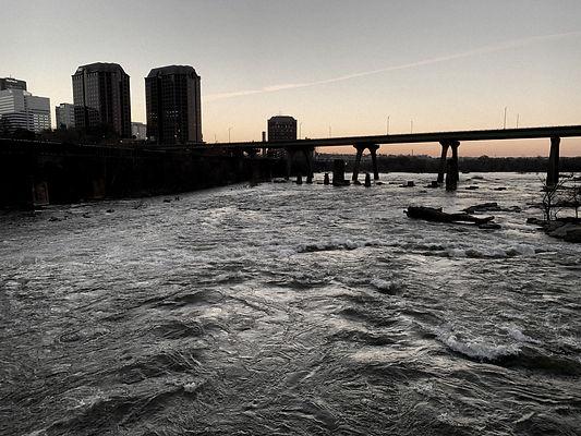 sunrise of Richmond, VA skyline, bridge and James River