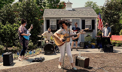 Girl lead rock band performing in garden