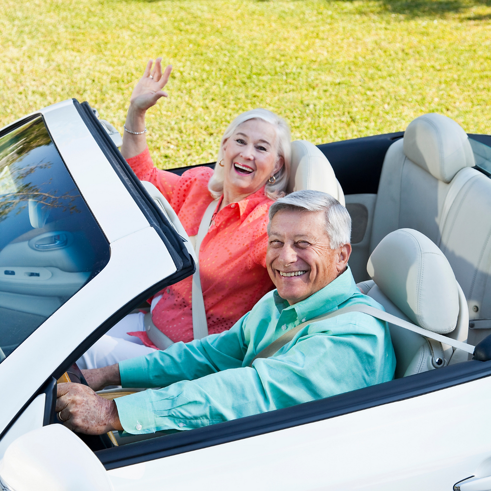 Retired couple in a convertible