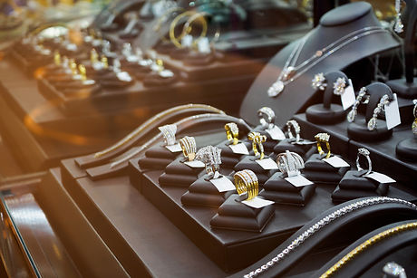 Gold jewelry diamond shop with rings and