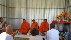 Monks inside of house
