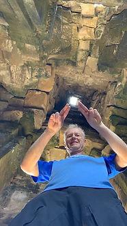 Rolf in tomb.JPG