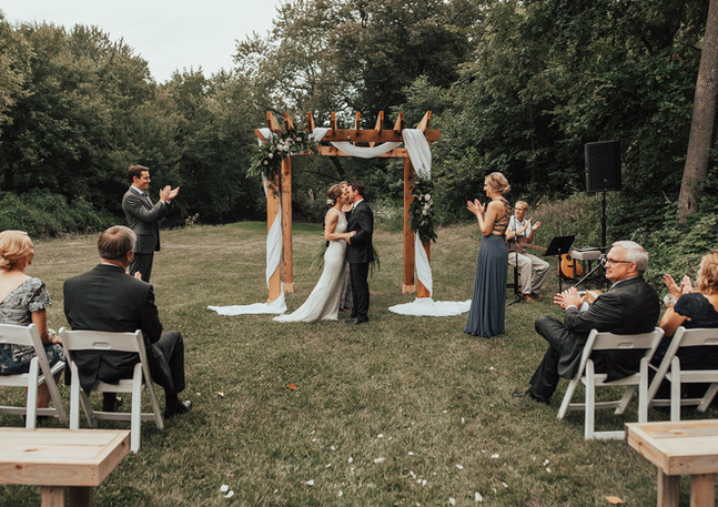 Outdoor ceremony photo by The Jeno Collective