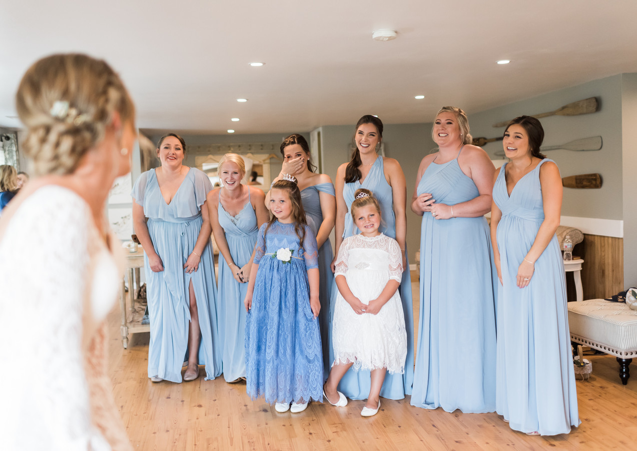 Bridal first looks in the bridal suite by GG Photography