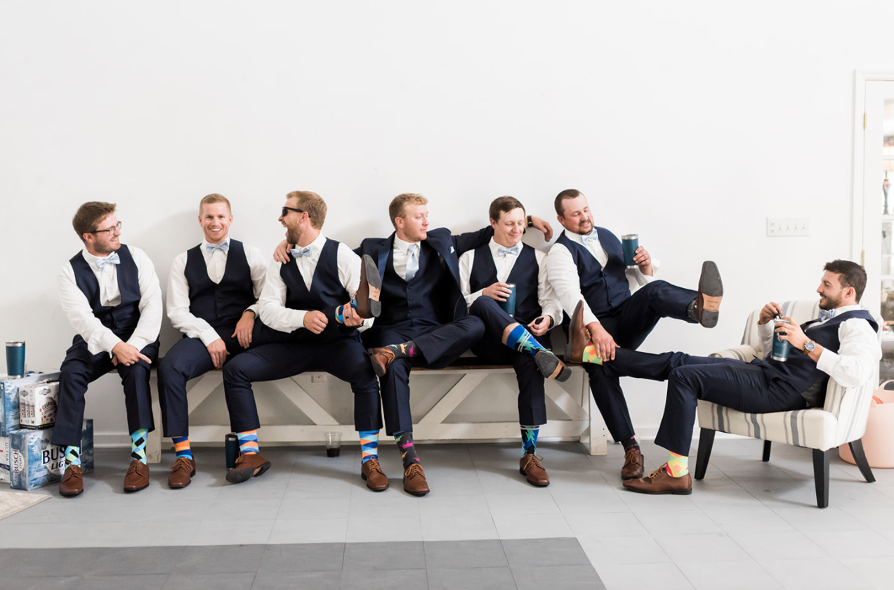 Photo in the groom's lounge by GG Photography