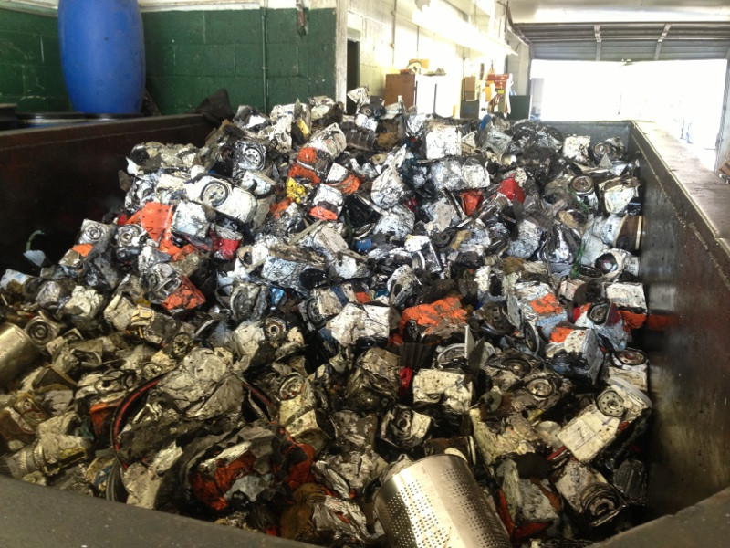 Thousands of Crushed Drained used Oil Filters recycling, long island, ny
