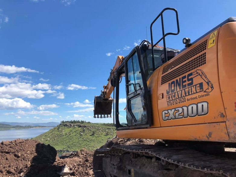 excavator across from lake.jpg