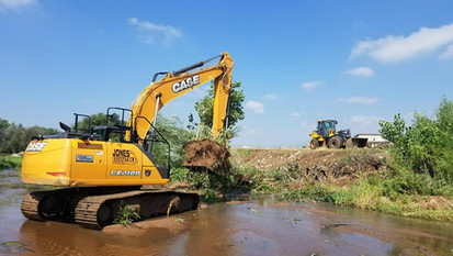 Excavator in creek.jpg