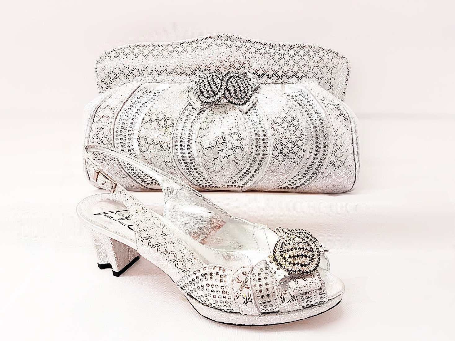 2cd06f70bc176 These shimmering open toe shoes and matching bag sets created by the up and  coming Italian designer, Luigi Salgati, have a built-in platform, ...