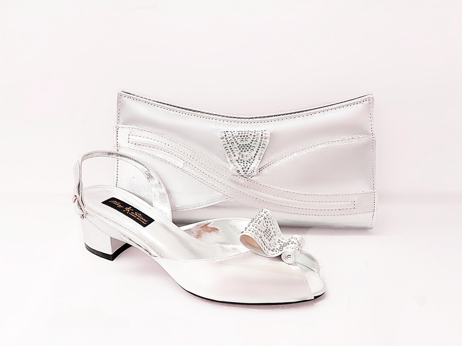 561ac2c28 A Mary Shoes signature style, these beautifully crafted low heel wedding  shoes feature a distinctive stone embellished bow, a chunky heel and a  slingback ...
