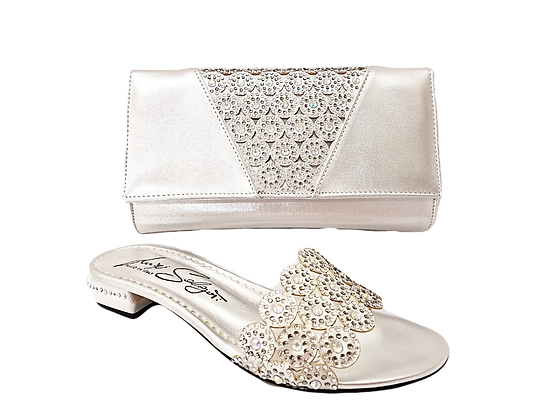 Fiorella, silver laser-cut low wedding sandals and matching bag