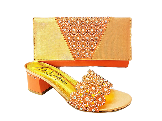 Fiorella, peach laser-cut mid-height sandals and matching bag
