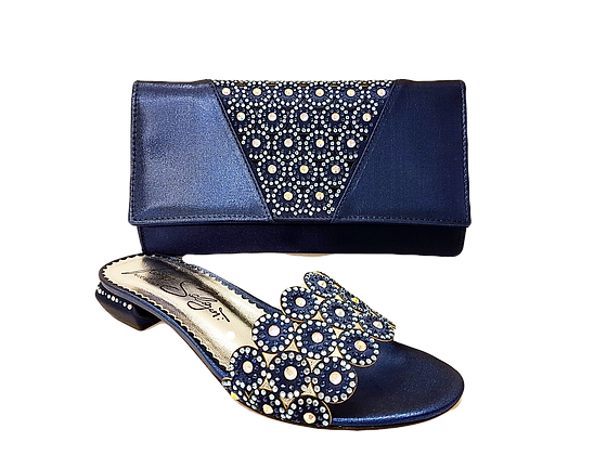 Fiorella, navy laser-cut low wedding sandals and matching bag