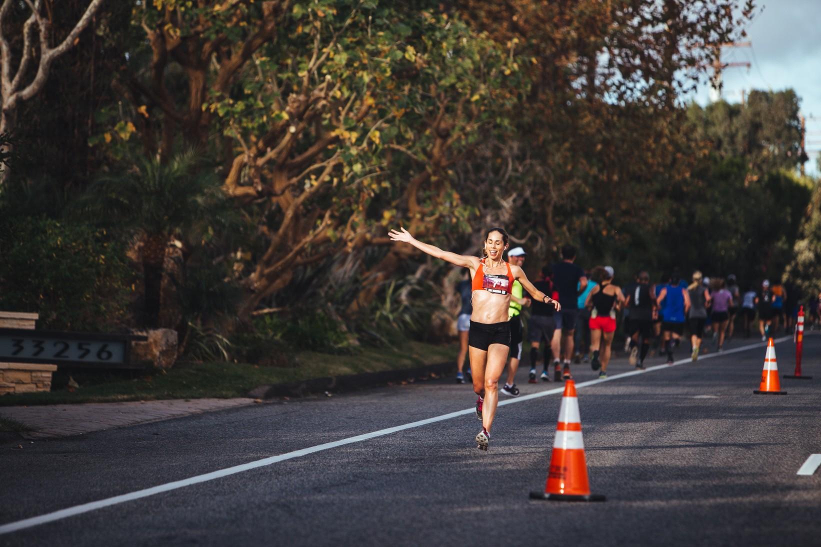 Liz Blackwell passes the finish line to take first place in the Malibu Half Marathon.