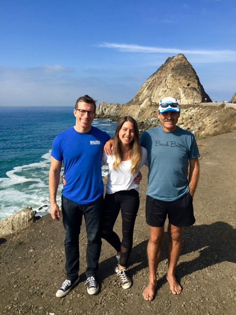 The Malibu Half Marathon & 5K team with Mugu Rock, one of the most distinctive landmarks on PCH, serving as a backdrop.