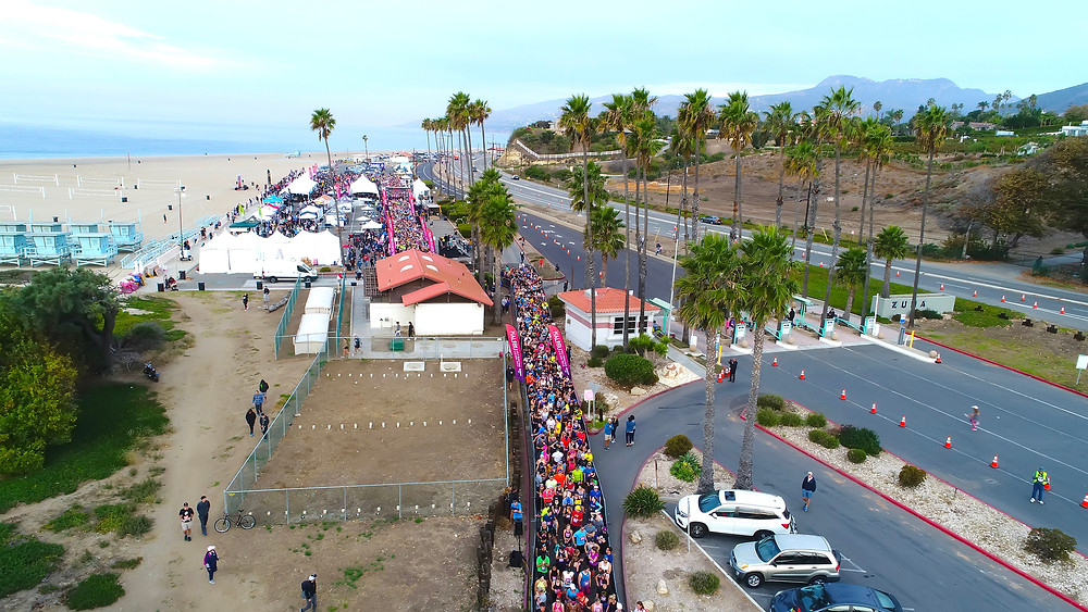 Zuma Beach, malibu and the Pacific Coast Highway serving as the backdrop to your race.