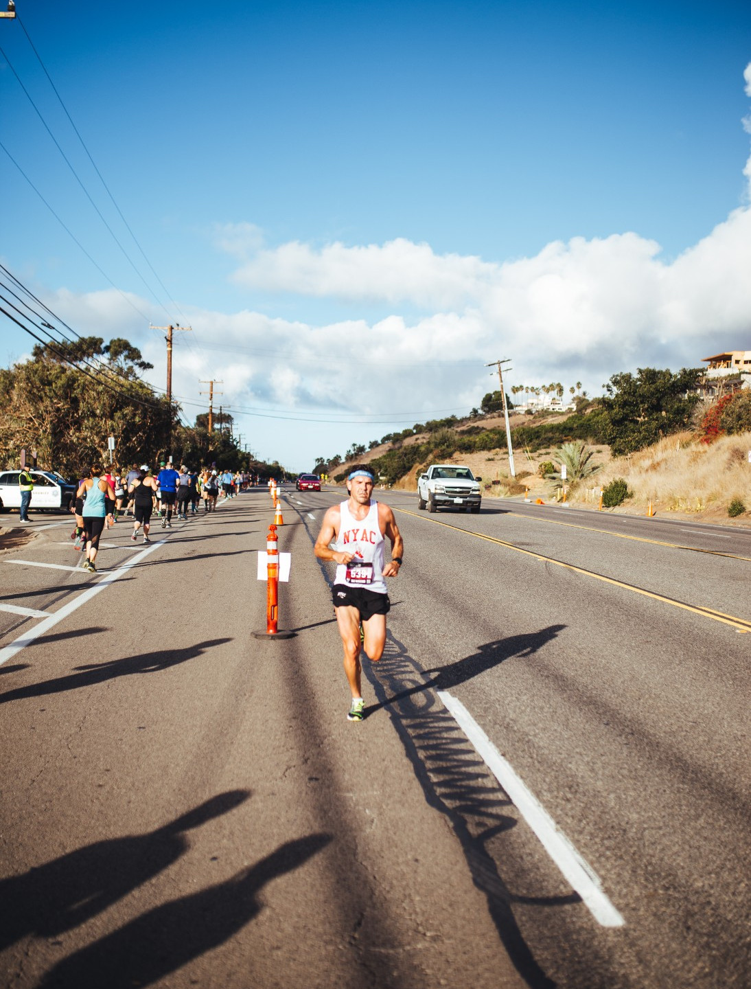 First-place half marathon finisher Kenneth Rideout sets back to the Finish Line.