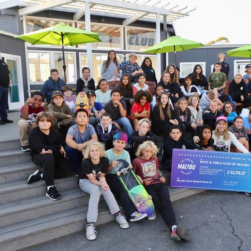 Malibu race Donating a check to the Boys and Girls Club of Malibu
