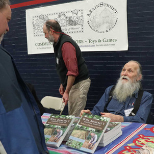 Author Will Bonsall signing books