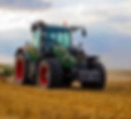 green-tractor-plowing-the-fields-on-focu