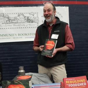 Author Philip Ackerman-Leist signing books