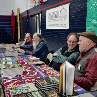 Authors stationed a the Green Market fair during book signings