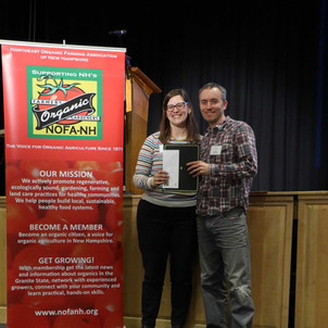 Board President Amy Manzelli presented Justin Munroe with the 'Leading Gardener of the Year' Award