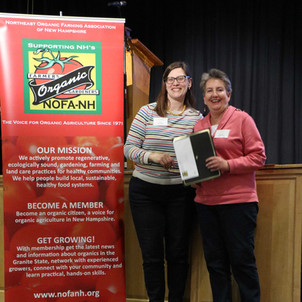 Board President Amy Manzelli presented Lorna Austin with the 'Volunteer of the Year' Award