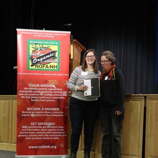 Board President Amy Manzelli presented Jenny Wooster with the 'Community Partner of the Year' Award