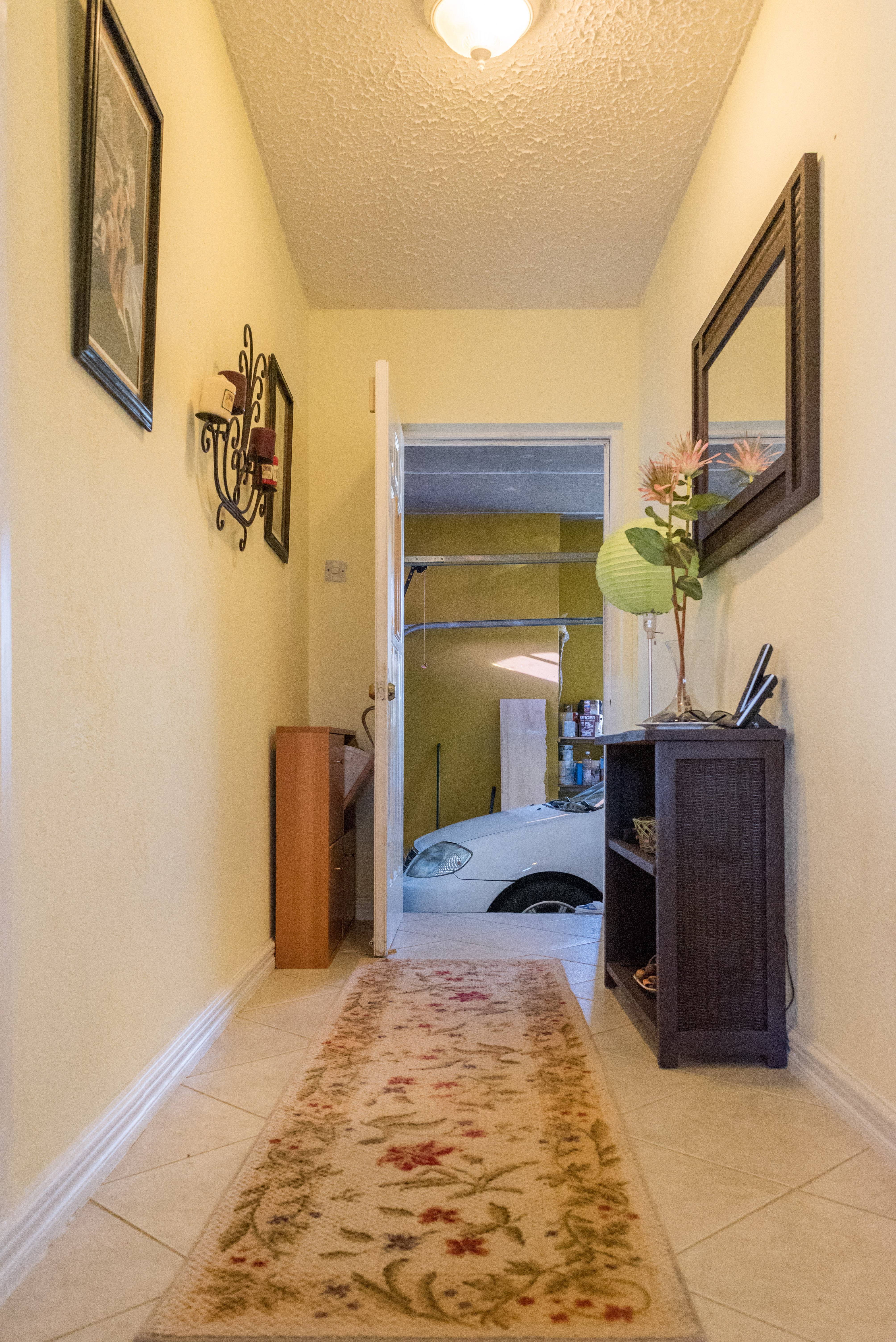 EMERALD LIVING | Hallway to garage