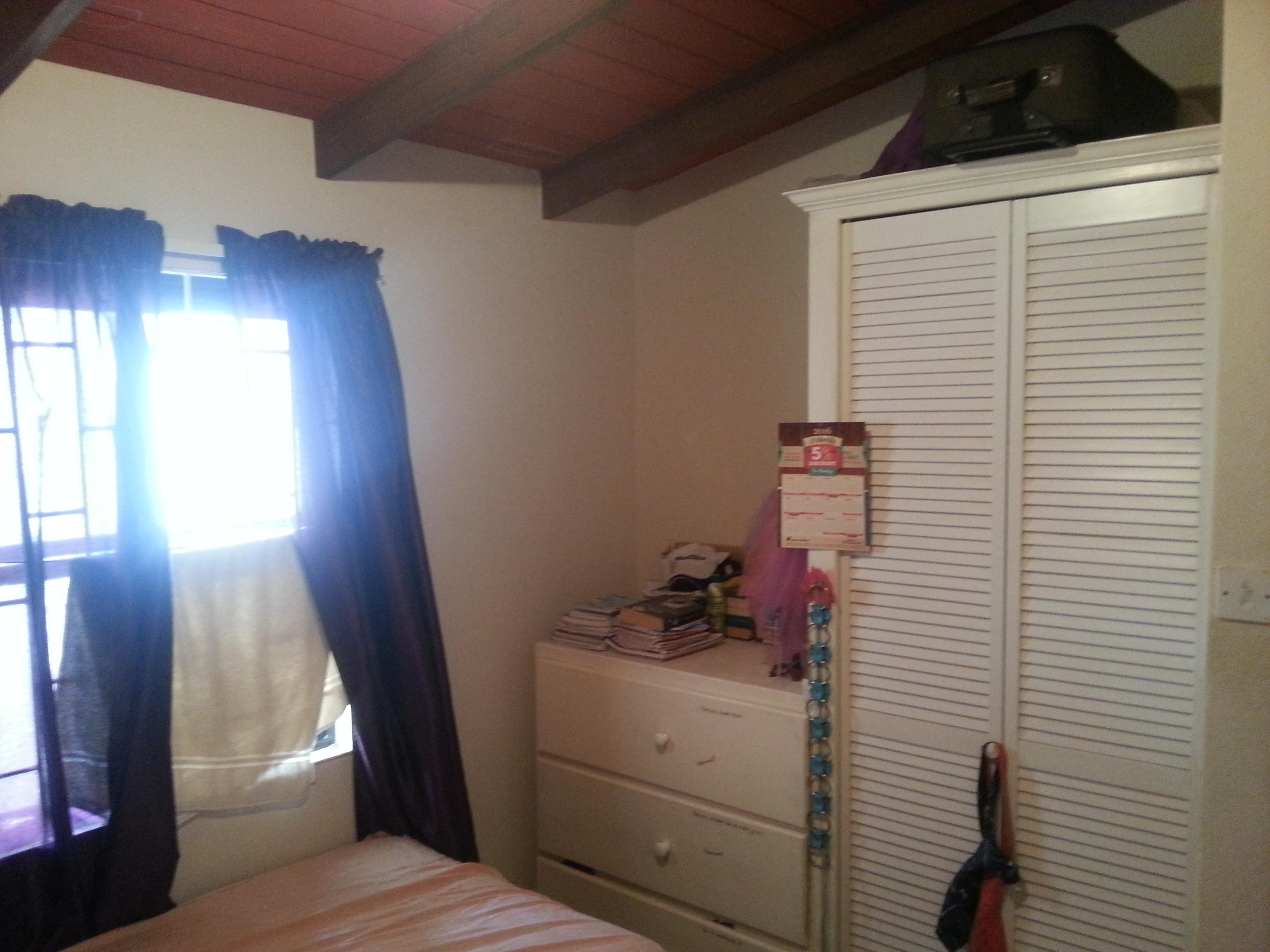EMERALD LIVING | Third Bedroom