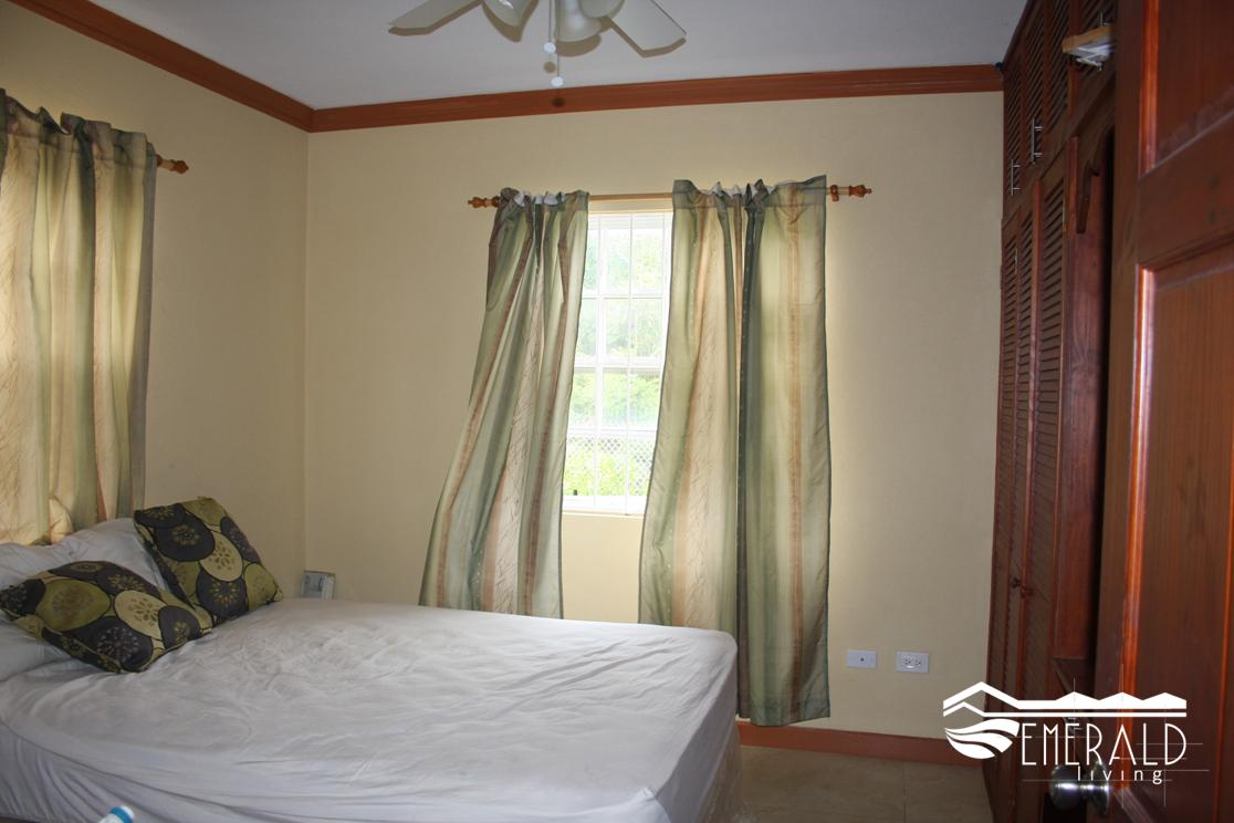 EMERALD LIVING | First Bedroom