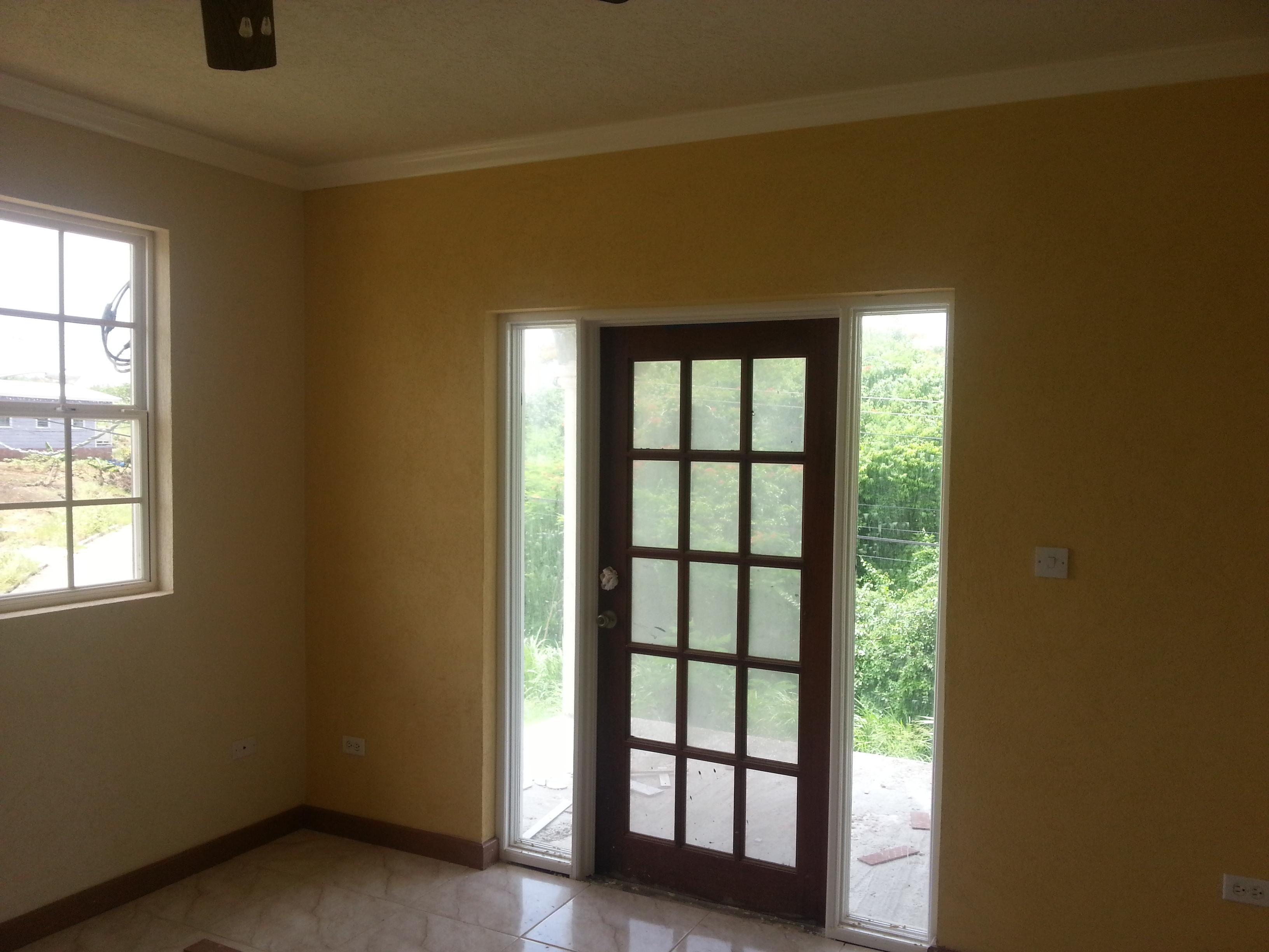 EMERALD LIVING | Front Door to Patio