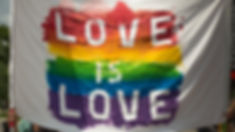 Canva - White and Multicolored Love Is L