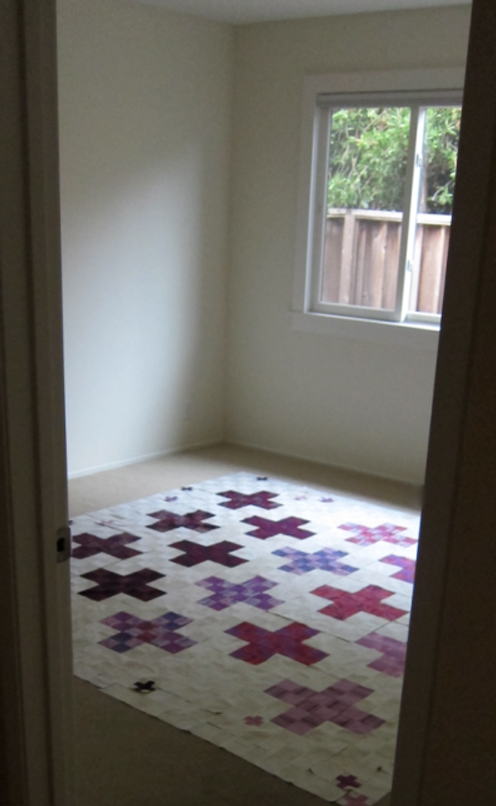 The quilt that livings on the floor of the guest-room-in-the-making.