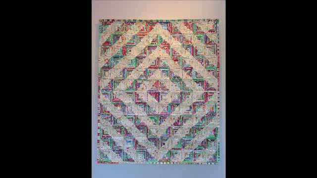 """Kentucky Quilt #2, 64"""" x 76"""", made by Tom Pfannerstill, 1998, found cigarette packages on canvas. This unique interpretation of the traditional Log Cabin appears in the documentary Why Quilts Matter: History, Art, and Politics."""