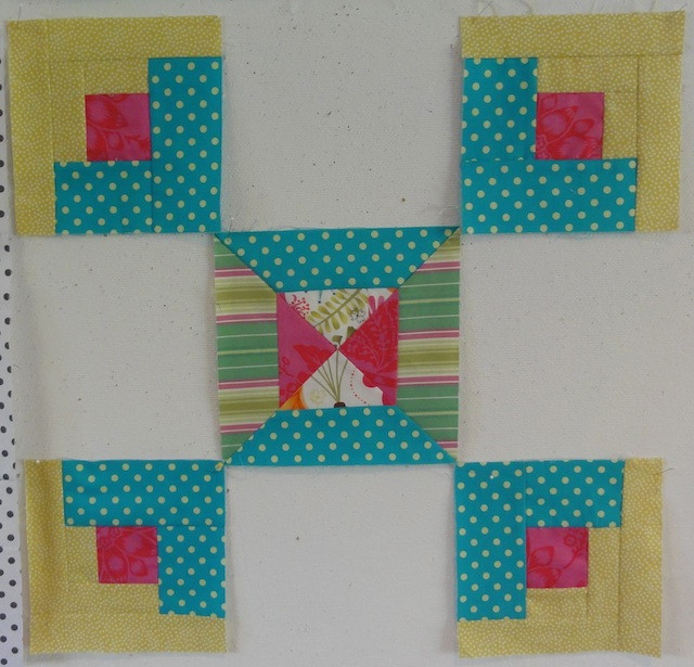 One Strippy Spool block combined with the Log Cabin blocks.