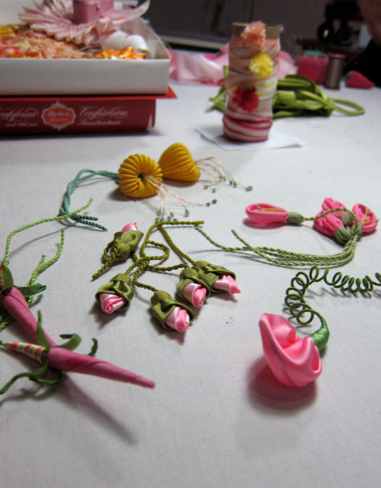 What's on Candace's work table? Trippy Japanese lanterns, rosebuds, and other fanciful flowers.