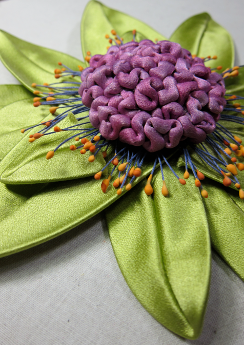 Straight from her worktable--a pretty blossom with handmade stamens and a center with cording hand dyed by a student and sculpted by Candace