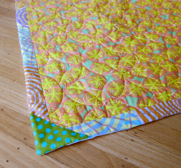 Completed faced binding with accent triangle.