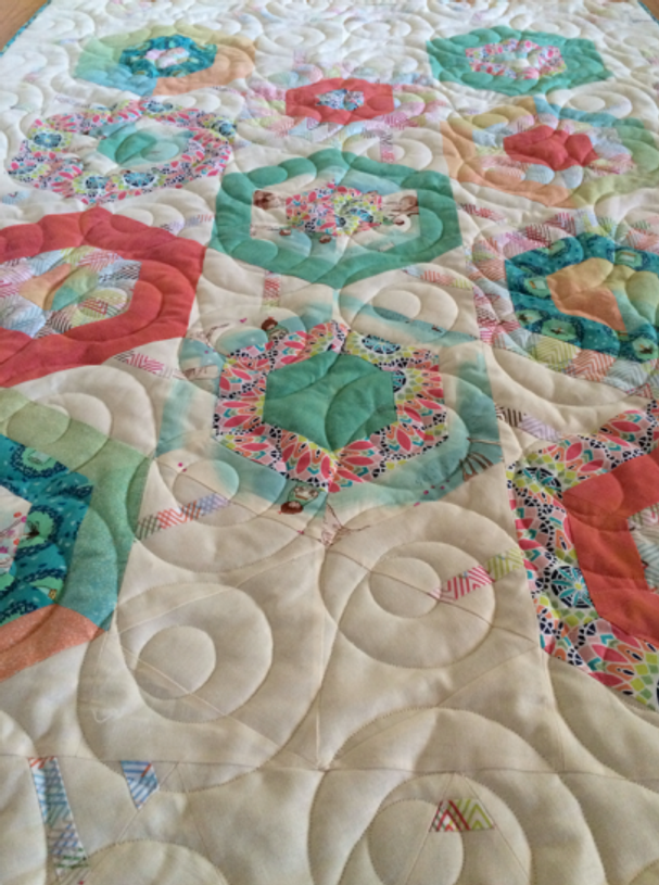 Detail view of the long-arm quilting of Cyndy Rymer.