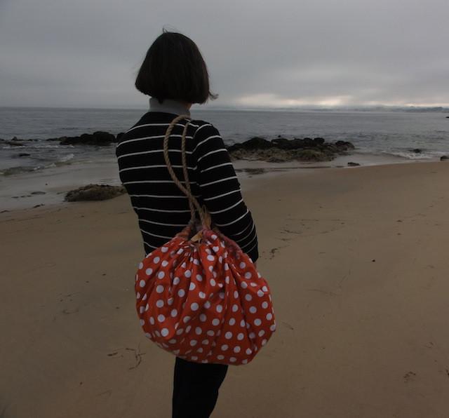 A calm grey overcast morning at the beach.