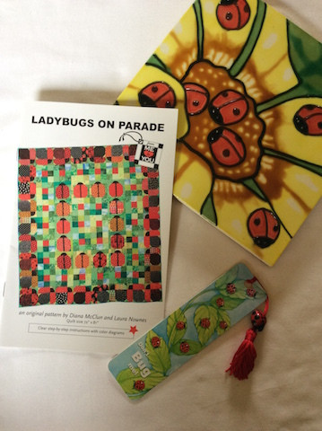 """""""Ladybugs on Parade"""" pattern designed by Diana McClun and Laura Nownes."""
