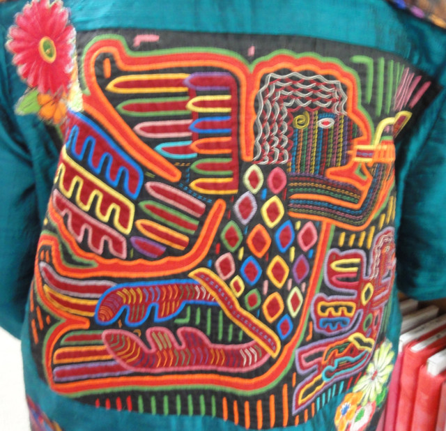 A 1960s mola is added to the back of this jacket.