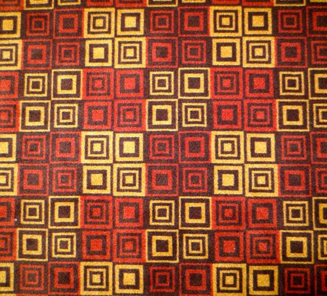 The carpet in the atrium of our hotel in Austin. Do I see a quilt?